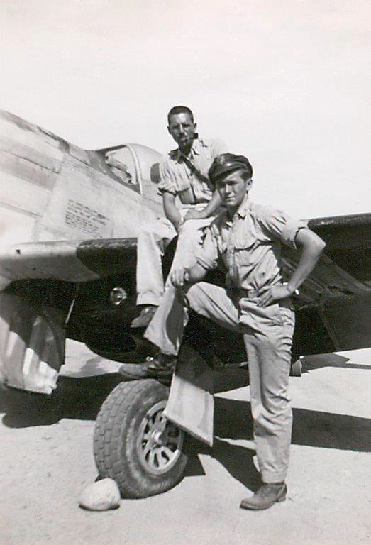 Villchur (left) and a pilot in front of a P-51 Mustang, one of the planes Villchur worked on