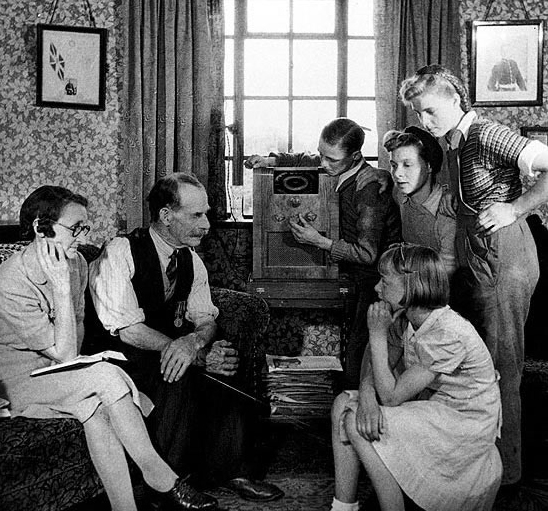 American families in the 1930s and 1940s enjoyed listening to the radio after dinner.