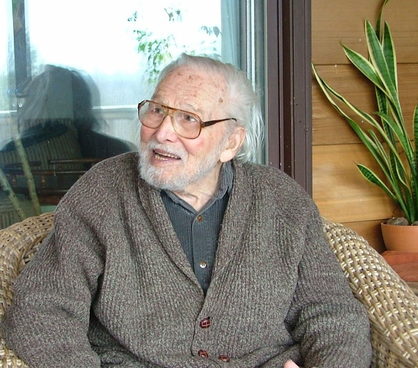 Edgar Villchur, age 88, wearing his favorite sweater, a wool cardigan with leather buttons.